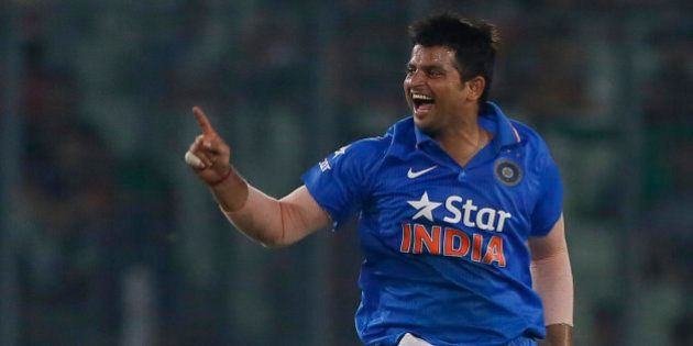 India's Suresh Raina, celebrates after the dismissal of Bangladesh's Mushfiqur Rahim during their...