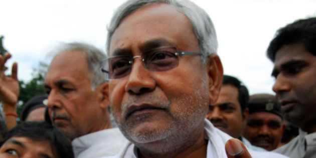 FILE - In this Nov. 1, 2010 file photo, Bihar state Chief Minister Nitish Kumar displays the indelible...
