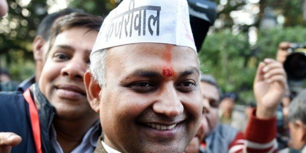 Senior Leader of India's Aam Aadmi Party (AAP) Somnath Bharti (C) arrives for a meeting in New Delhi...