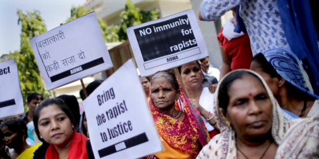 Activists of All India Democratic Women's Association hold placards during a protest outside the Saudi...