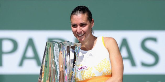 INDIAN WELLS, CA - MARCH 16: Flavia Penneta of Italy poses with the trophy following her WTA women's...