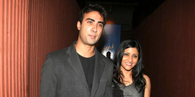 Indian Bollywood actors Ranvir Shorey (L) and his wife Konkona Sen Sharma (R) attend a Chivas promotional...