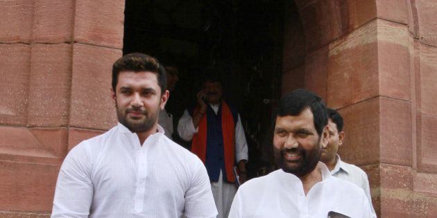 NEW DELHI, INDIA - AUGUST 5: Lok Janshakti Party supremo Ram Vilas Paswan with son Chirag Paswan at Parliament...
