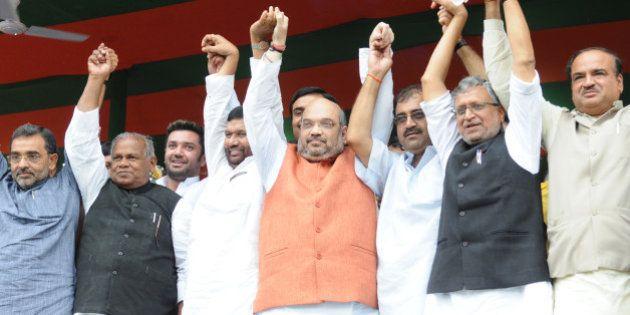 PATNA, INDIA - JULY 16: BJP Chief Amit Shah with LJP Chief Ram Vilas Paswan, HAM Chief Jitan Ram Manjhi,...