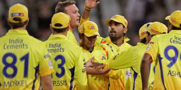 Chennai Super Kings Faf du Plessis, second left, reacts with team members as they take the wicket of...