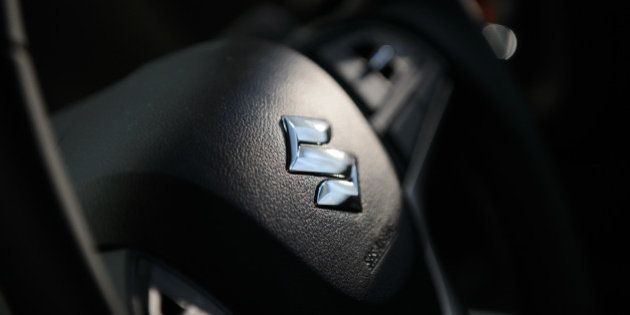 The Suzuki Motor Corp. logo sits on the steering wheel of the company's new Solio Bandit vehicle during...