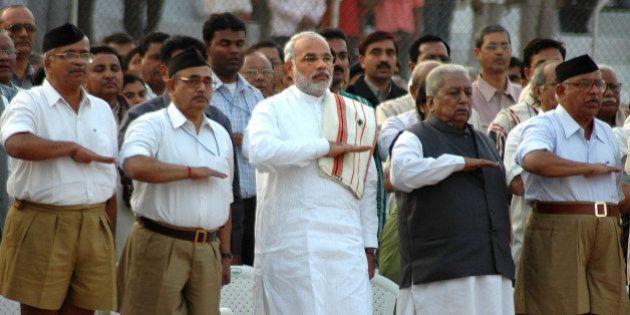 Gujarat state chief minister Narendra Modi, third left, former chief minister Keshubhai Patel, second...