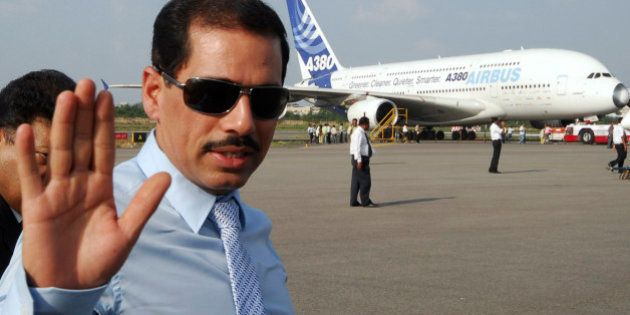 Robert Vadra, the son-in-law of the head of India's ruling Congress party, Sonia Gandhi waves after...