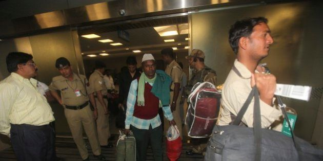 Indian laborers who were evacuated from Libya because of the ongoing conflict, arrive at the International...