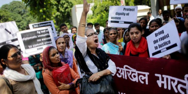 Activists of All India Democratic Women's Association shout slogans during a protest outside the Saudi...