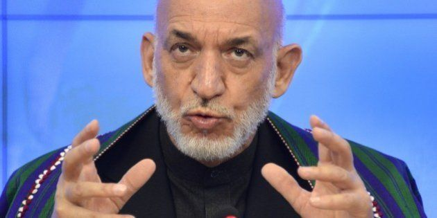 Former Afghan President Hamid Karzai speaks during a press conference in Moscow on June 25, 2015. AFP...