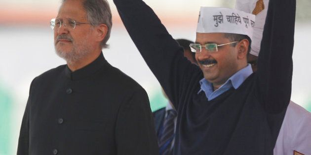 Aam Aadmi Party, or Common Man's Party, leader Arvind Kejriwal greets the crowd after taking oath as...