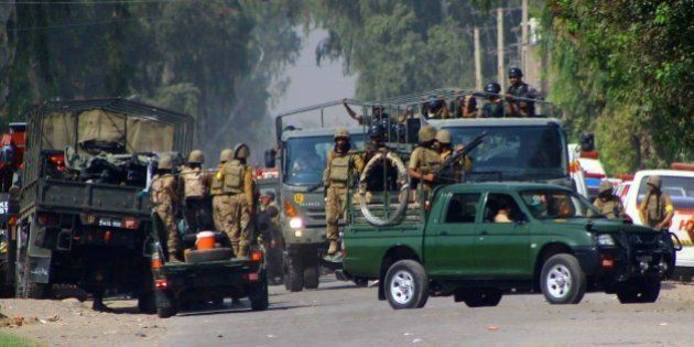 PESHAWAR, PAKISTAN - SEPTEMBER 18: Pakistani soldiers cordon off the area outside an air force base attacked...