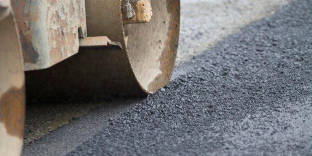 Industry Paving Machine rolling over fresh