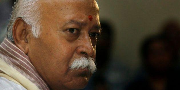 Mohan Bhagwat, chief of the Rashtriya Swayamsevak Sangh (RSS), or the National Volunteers Force, gestures...