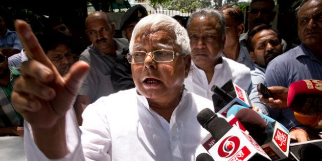 Rashtriya Janata Dal (RJD) leader Lalu Prasad Yadav speaks to reporters after a meeting with Samajwadi...