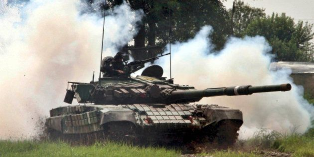 JAMMU, INDIA - AUGUST 10: Indian Army tank perform drill during an event to mark the victory of 1965...