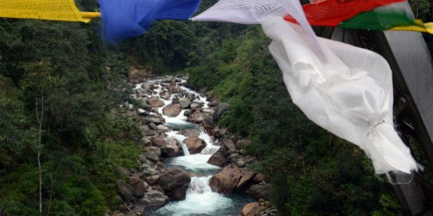 Buddhist prayer flags are pictured from a bridge in Pelling, India's Sikkim state, on December 19, 2013....