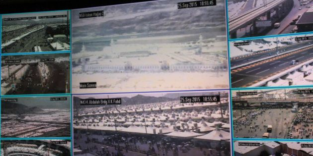 Muslim pilgrims attending the annual hajj pilgrimage are seen on CCTV screens at a security command in...