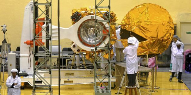Scientists and engineers work on a Mars Orbiter vehicle at the Indian Space Research Organisation's (ISRO)...