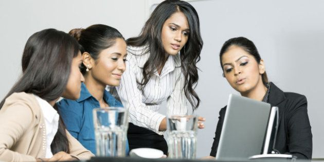 Indian female business colleagues working around a