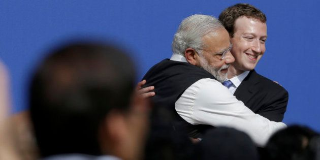 Facebook CEO Mark Zuckerberg, right, hugs Prime Minister of India Narendra Modi at Facebook in Menlo...
