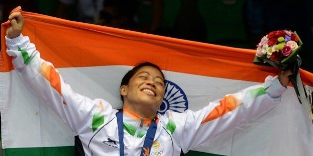 Gold medallist India's Hmangte Chungneijang Mary Kom celebrates during the victory ceremony after winning...
