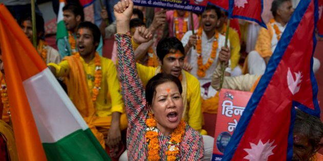 A Nepali woman shouts slogans during a protest against the Nepalese government and demanding it be restored...