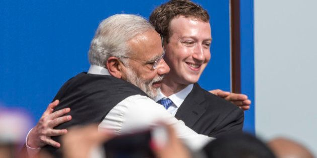 Narendra Modi, India's prime minister, left, and Mark Zuckerberg, chief executive officer of Facebook Inc., embrace at the conclusion of a town hall meeting at Facebook headquarters in Menlo Park, California, U.S., on Sunday, Sept. 27, 2015. Prime Minister Modi plans on connecting 600,000 villages across India using fiber optic cable as part of his 'dream' to expand the world's largest democracy's economy to $20 trillion. Photographer: David Paul Morris/Bloomberg via Getty Images