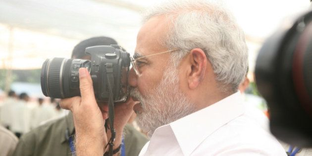INDIA - NOVEMBER 12: Narendra Modi, Chief Minister of Gujarat with Camera in Gujarat, India ( Photographer...