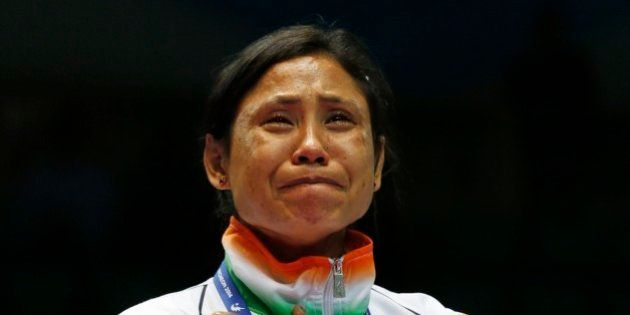 FILE - In this Oct. 1, 2014 file photo, India's L. Sarita Devi cries after she refused her bronze medal...