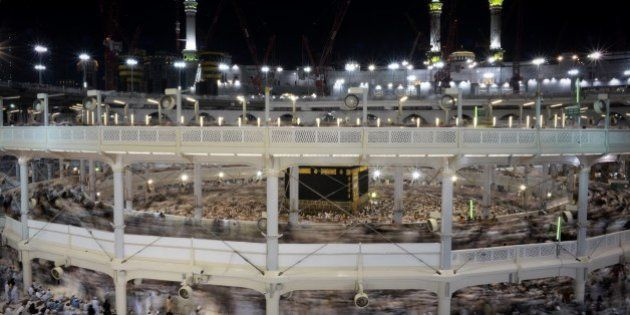 Muslim pilgrims circle counterclockwise Islam's holiest shrine, the Kaaba, at the Grand Mosque in Saudi...