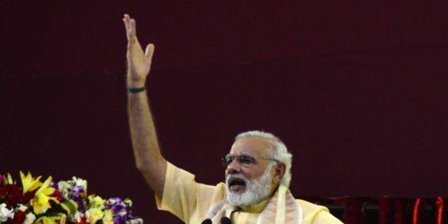 VARANASI, UTTAR PRADESH, INDIA - 2015/09/18: Prime minister Narendra Modi addressing a public rally after...