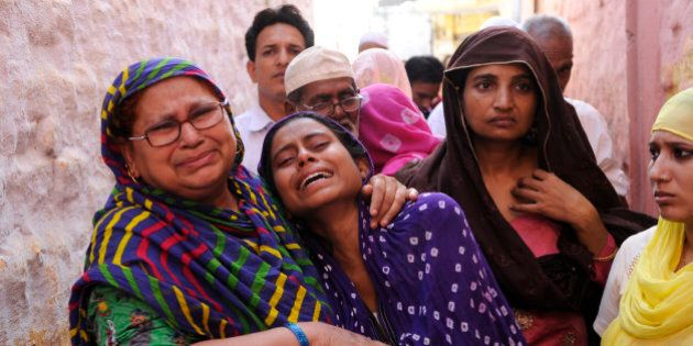 GREATER NOIDA, INDIA - SEPTEMBER 29: Family members of Mohammad Akhlaq (50-year-old man) mourn during...
