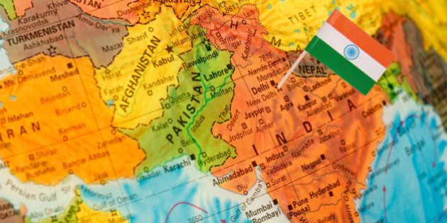 map with miniature flag of India.Selective focus on Indian Flag. Backlit