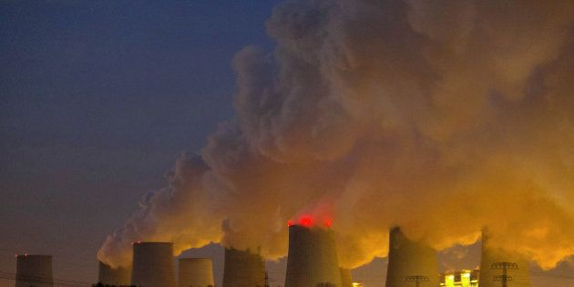 Vapor escapes from cooling towers at the lignite coal-fired power plant operated by Vattenfall AB, in...