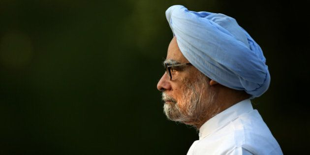 Outgoing Indian prime minister Manmohan Singh leaves after paying homage to former Indian prime minister...
