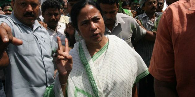 KOLKATA, INDIA � JUNE 2: Railway minister and TMC chief Mamata Bannerjee with her supporters after...