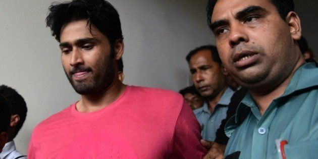 Bangladeshi security personnel escort fugitive cricketer Shahadat Hossain (C) after he surrendered in...
