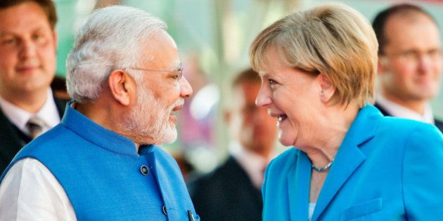 NEW DELHI, INDIA - OCTOBER 05: German Chancellor Angela Merkel and India's Prime Minister Narendra Modi...