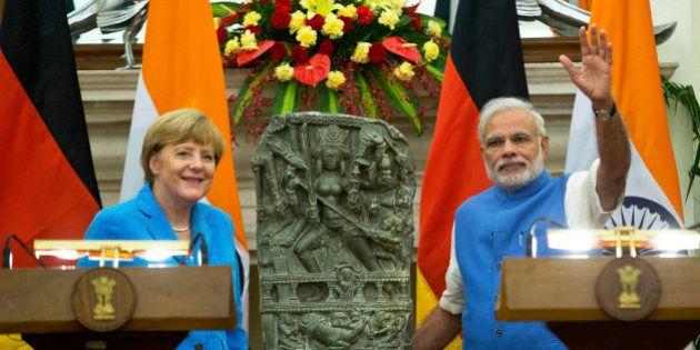 German Chancellor, Angela Merkel, left, and Indian Prime Minister Narendra Modi pose for a photograph...