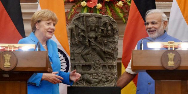 German Chancellor Angela Merkel, left and Indian Prime Minister Narendra Modi, pose with a tenth century...