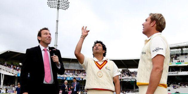 LONDON, ENGLAND - JULY 05: MCC captain Sachin Tendulkar tosses the coin alongside Rest of the World captain...