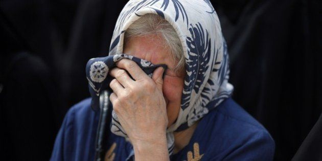 An Iranian woman mourns during a funeral procession for some of the Iranian pilgrims who were killed...