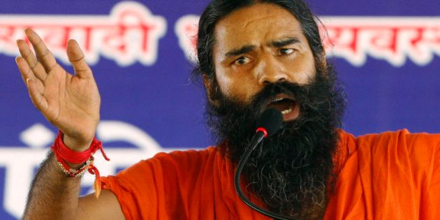 Indian yoga guru Baba Ramdev gestures as he speaks to his supporters at an anti-corruption protest in...