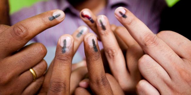 Indian youths showing their mark after voting in the General Elections in India. This mark is an indication...