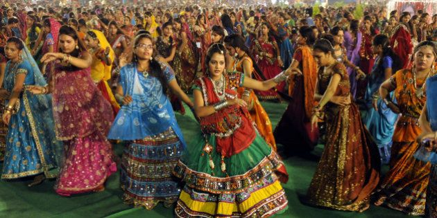 INDORE, INDIA - SEPTEMBER 25: Girls take part in Garba dance on the first day of Navratri festival near...