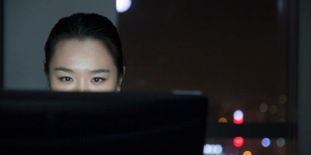 Chinese businesswoman working late in