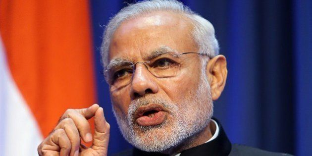 Indian Prime Minister Narendra Modi gestures as he delivers a joint press conference with the Irish prime...
