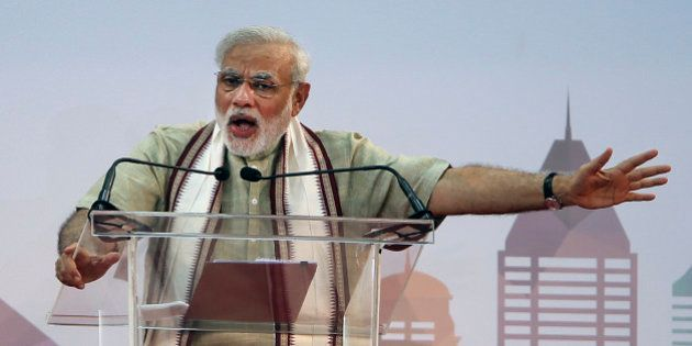 Indian Prime Minister Narendra Modi addresses Indian expatriates at a cricket stadium, Monday, Aug. 17,...